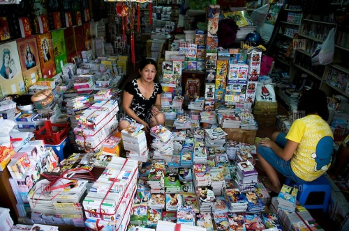 Vietnamese women selling books in a shop of Ho Chi Minh city, Vietnam, Asia